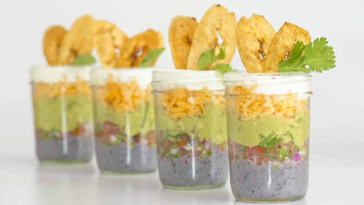 Five layer dip in mason jars, plantain chips