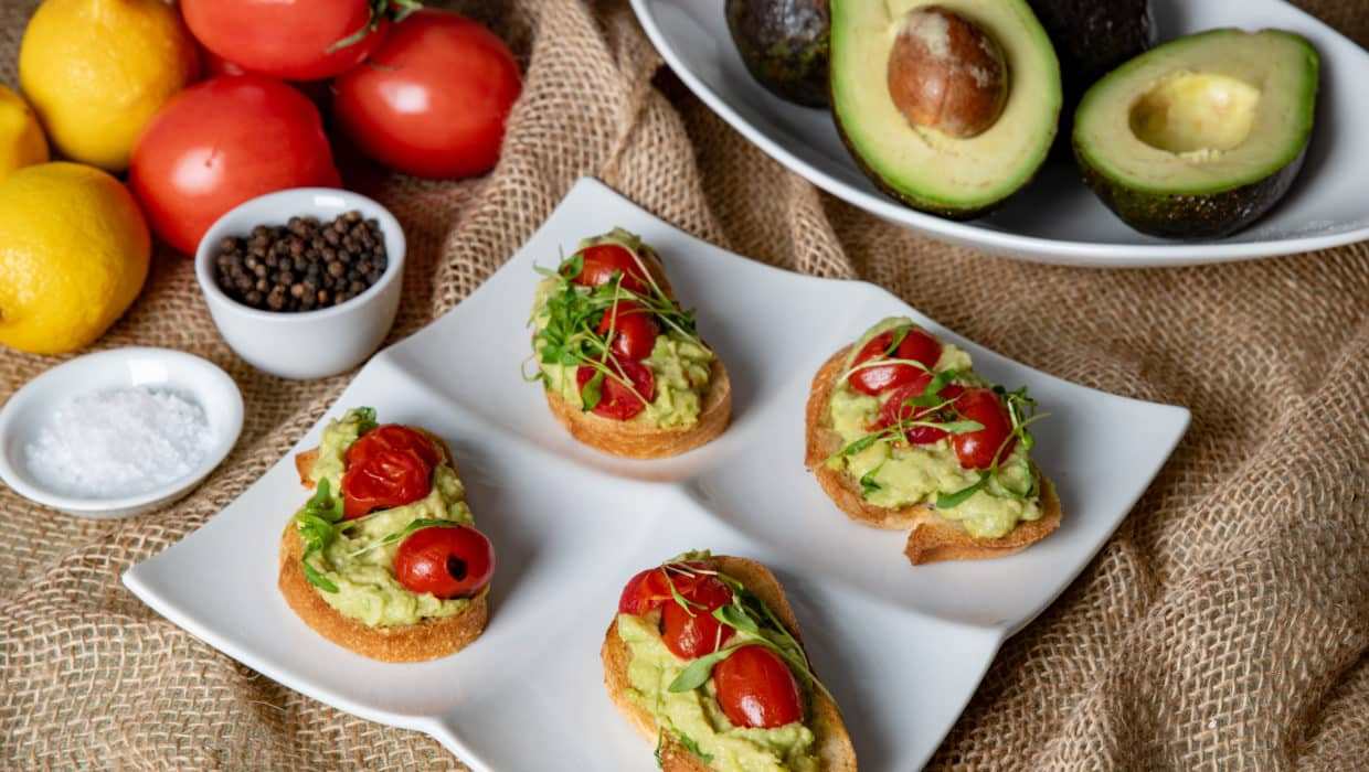 Avocado toast with blistered tomatoes