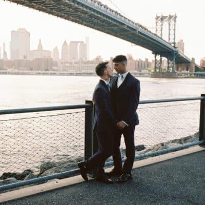 Mr. and Mr. under the bridge on their wedding day