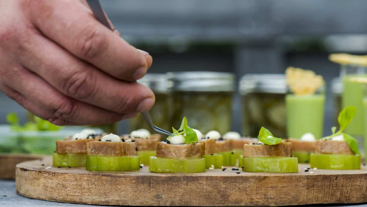 Event Chef placing micro greens on top of Hors d'Oeuvres