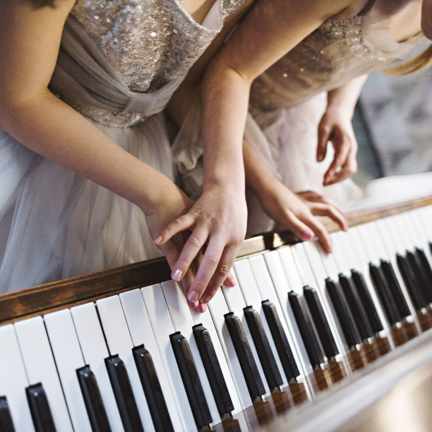 Flower girls playing piano