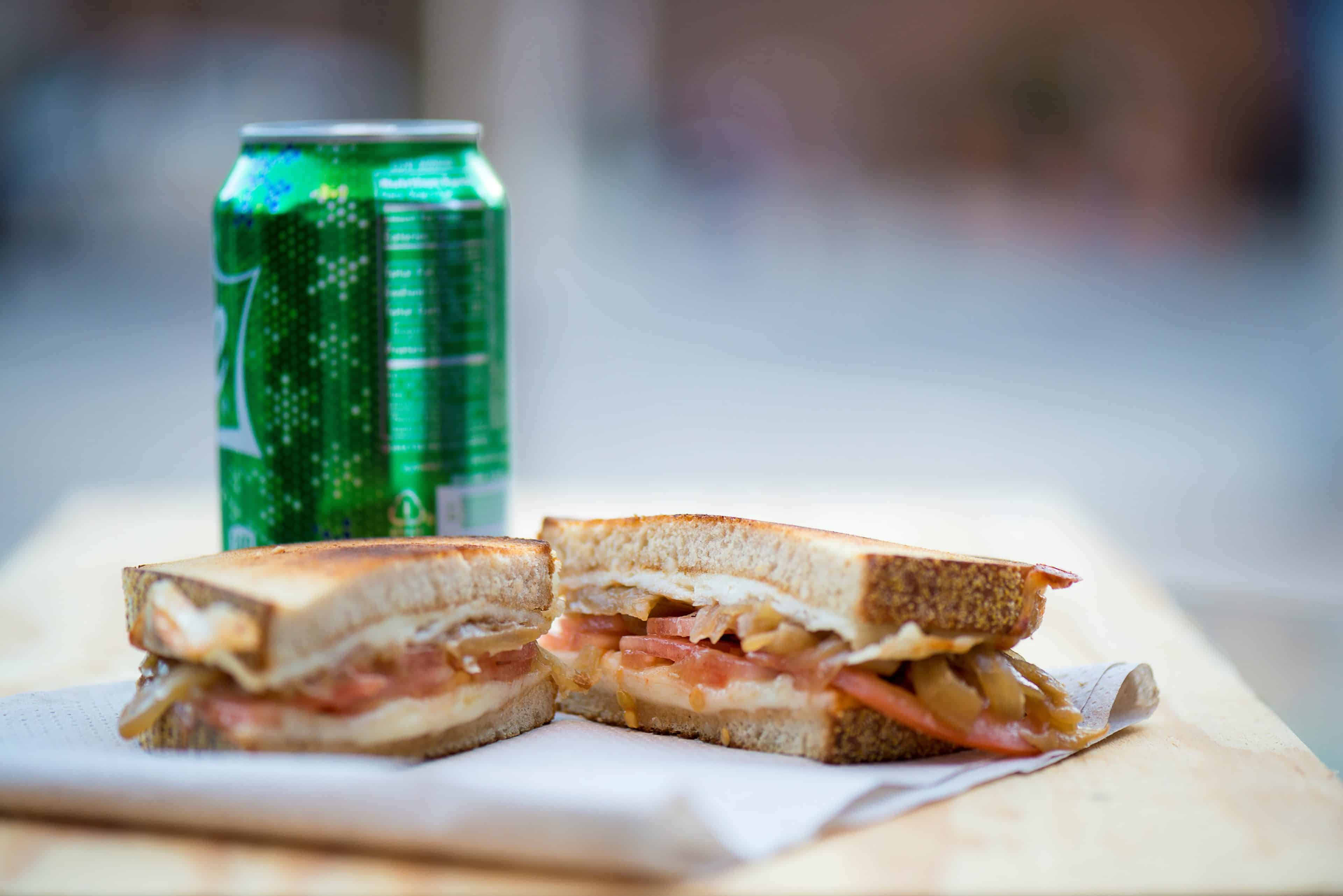 Grilled sandwich and a soda