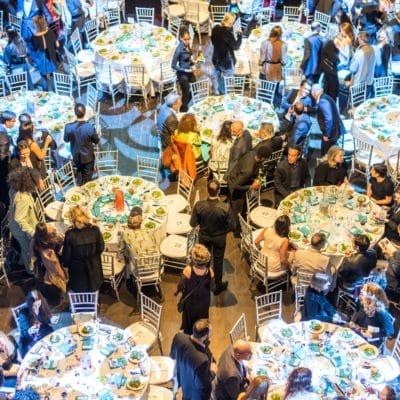 Caproate dinner event utilizing round tables