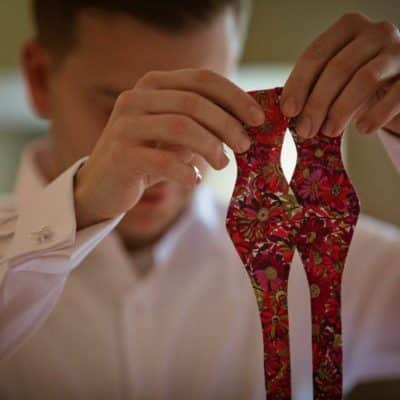 Untied red floral bowtie